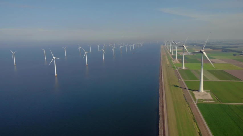 Windmill park green energy from drone view. windmill ofsshore wind farm in the Netherlands windmill turbines. High quality 4k footage Royalty-Free Stock Footage #1057290316