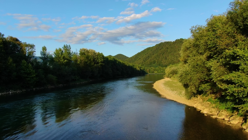 Calm Sava river flowing after merging with the Ljubljanica river in Podgrad Slovenia near the capital city of Ljubljana, Aerial flyover view Royalty-Free Stock Footage #1057301650