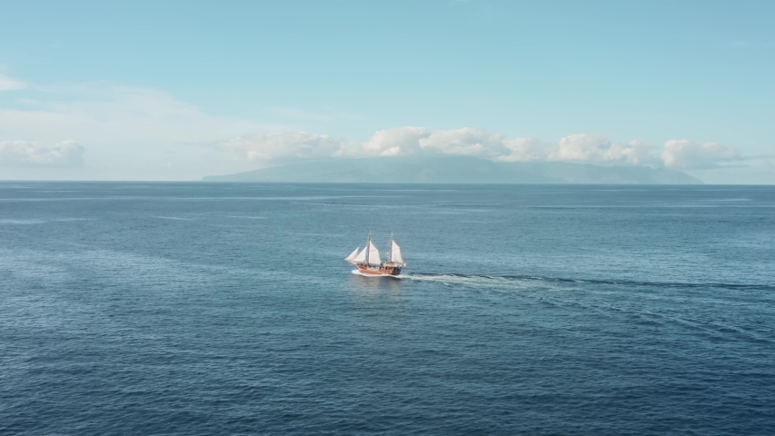 The romance of adventure, a lonely old pirate ship sailing in the open ocean. | Shutterstock HD Video #1057303669