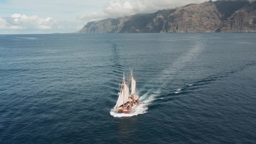 Old pirate ship sailing in the open ocean Royalty-Free Stock Footage #1057303675