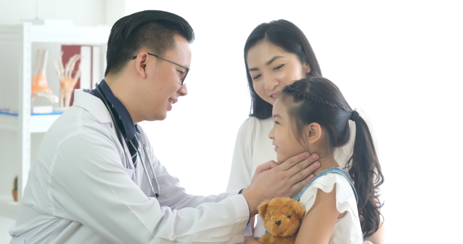 The doctor or physician touches the child neck to check for thyroid disease, tonsillitis And check the fever, the child is happy when he knows the health check results that he is normal. Royalty-Free Stock Footage #1057318516