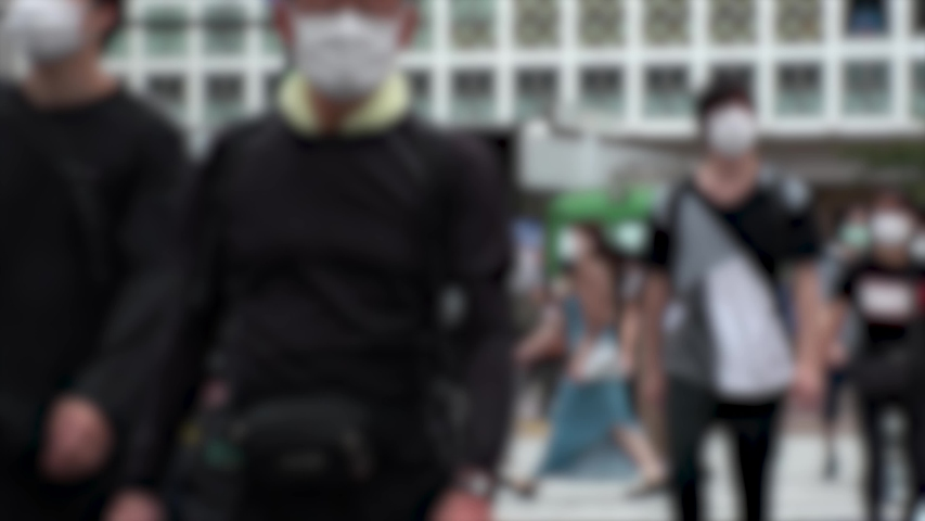 SHIBUYA, TOKYO, JAPAN - AUG 2020 : Crowd of people wearing surgical mask to protect from Coronavirus (COVID-19) at Shibuya Crossing. Shot in day time, hot summer season. Blurred shot. | Shutterstock HD Video #1057318900