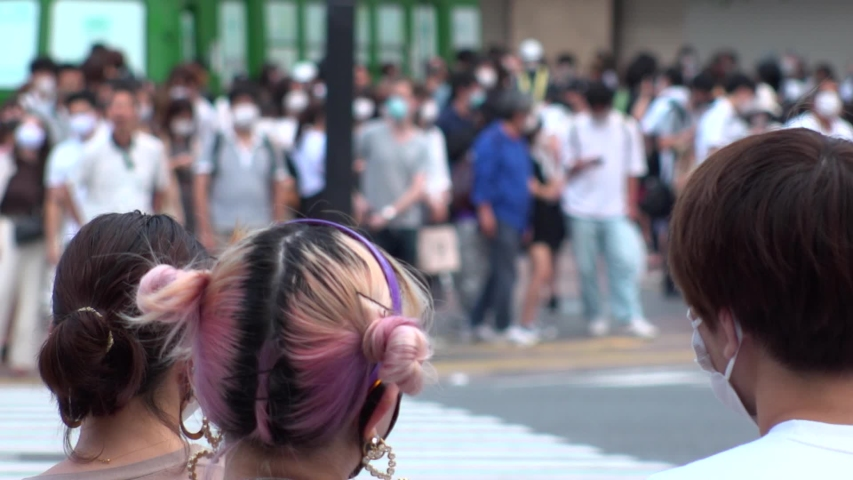SHIBUYA, TOKYO, JAPAN - AUG 2020 : Back shot and crowd of people wearing surgical mask to protect from Coronavirus (COVID-19) at Shibuya Crossing. Shot in day time, hot summer season. Slow motion. | Shutterstock HD Video #1057319059