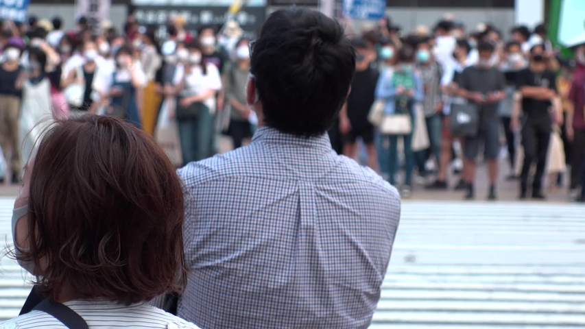 SHIBUYA, TOKYO, JAPAN - AUG 2020 : Back shot and crowd of people wearing surgical mask to protect from Coronavirus (COVID-19) at Shibuya Crossing. Shot in day time, hot summer season. Slow motion. | Shutterstock HD Video #1057319062