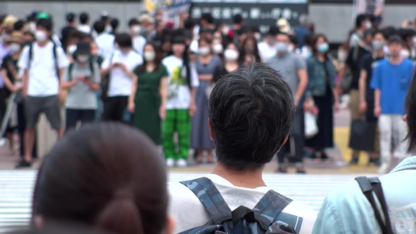 SHIBUYA, TOKYO, JAPAN - AUG 2020 : Back shot and crowd of people wearing surgical mask to protect from Coronavirus (COVID-19) at Shibuya Crossing. Shot in day time, hot summer season. Slow motion. | Shutterstock HD Video #1057319077