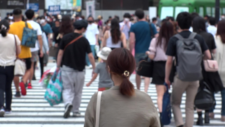 SHIBUYA, TOKYO, JAPAN - AUG 2020 : Back shot and crowd of people wearing surgical mask to protect from Coronavirus (COVID-19) at Shibuya Crossing. Shot in day time, hot summer season. Slow motion. | Shutterstock HD Video #1057319083