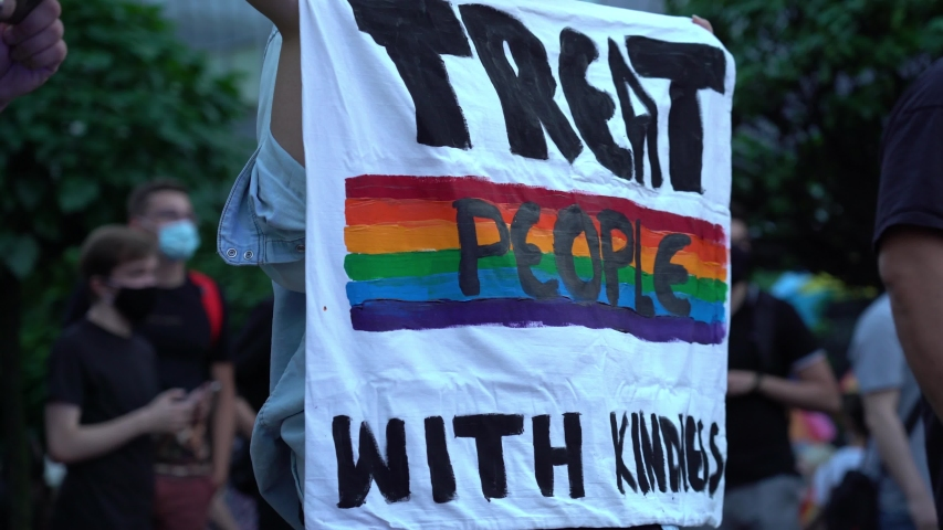 LGBT equality march. Fight for LGBTQ+ rights. Rainbow flags, banners and masks. Struggle for LGBT rights during coronavirus pandemic. | Shutterstock HD Video #1057333120