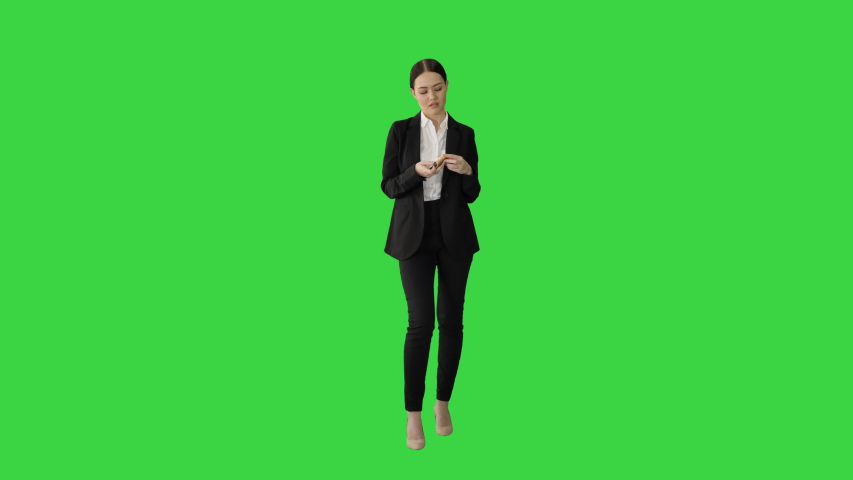 Brunette woman counting euro banknotes and looking to camera on a Green Screen, Chroma Key. | Shutterstock HD Video #1057333555