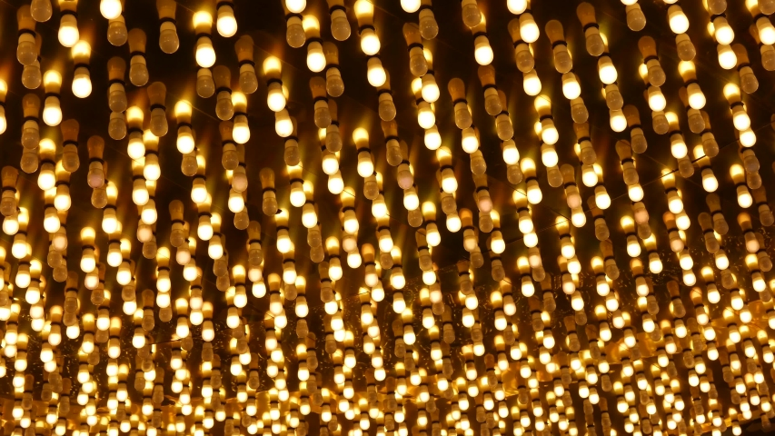 Old fasioned electric lamps blinking and glowing at night. Abstract close up of retro casino decoration shimmering in Las Vegas, USA. Illuminated vintage style bulbs glittering on Freemont street. | Shutterstock HD Video #1057335919