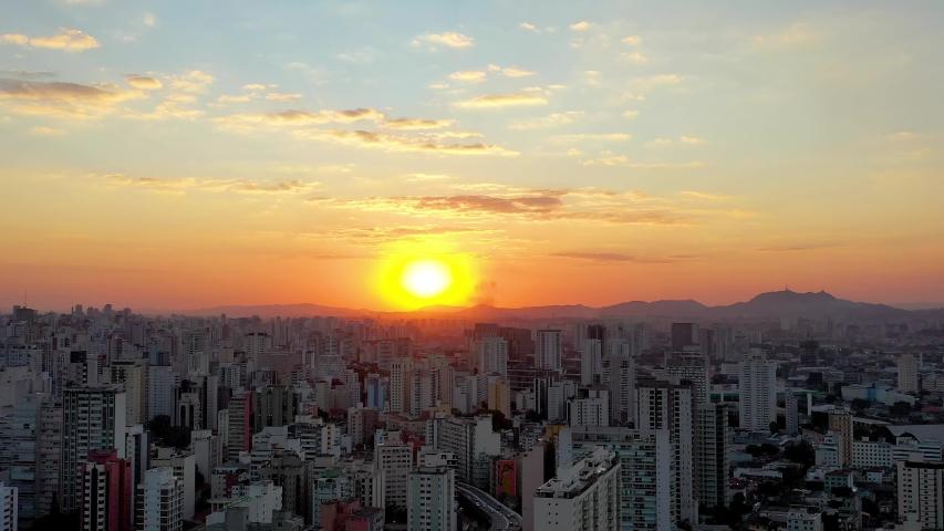 Autumn sunset in capital city, Sao Paulo, Brazil. Downtown scene. City life scene. Skyline city. Aerial view city. Urban life. Sunset sky. Urban background. Panoramic view sunset in São Paulo, Brazil | Shutterstock HD Video #1057338070