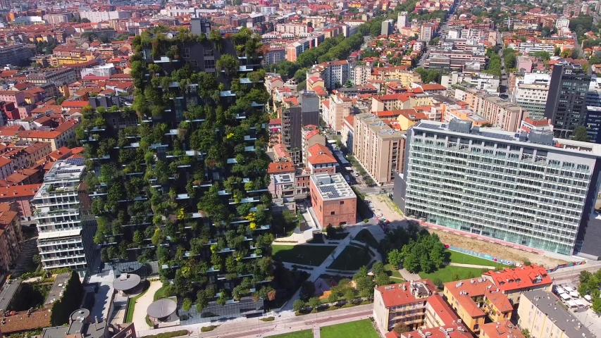 Milan Italy 10 August 2020: Vertical Forest is New Architecture in the new business center of Milan on Porta Nuova promenade. Office buildings. Drone shooting. Modern houses. Lombardy. finance. Bosco | Shutterstock HD Video #1057346710