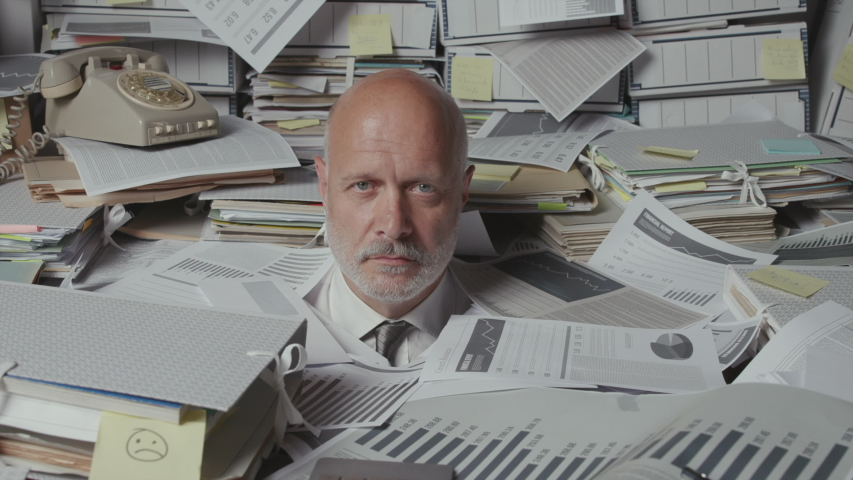 Stressed senior businessman in his messy office, he is overloaded with paperwork and screaming Royalty-Free Stock Footage #1057352146