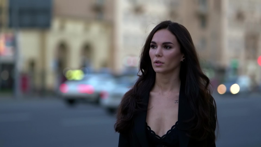 Beautiful brunette woman in big city, walking along road, looking for a taxi, checking mobile phone | Shutterstock HD Video #1057353973