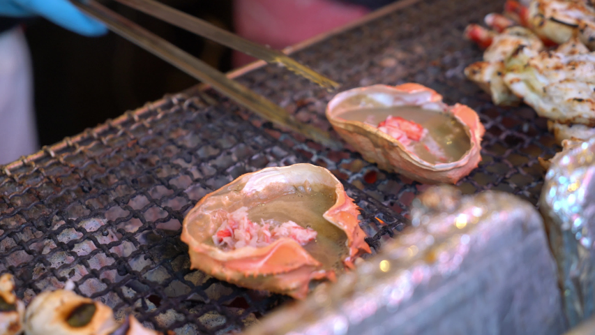Grilled crab shell in Japanese style - street food | Shutterstock HD Video #1057364218