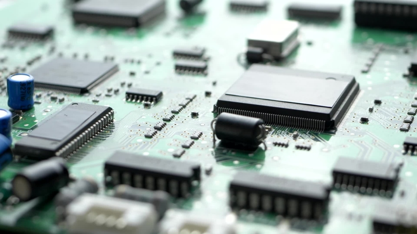 Electronic circuit board with processor, chips and capacitors. Tech science, computer chip, quality control background Royalty-Free Stock Footage #1057381891
