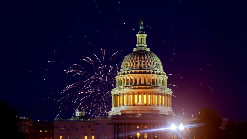 Mysterious night sky with full moon United States Capitol Building in Washington DC with Fireworks Background For 4th of July Independence Day