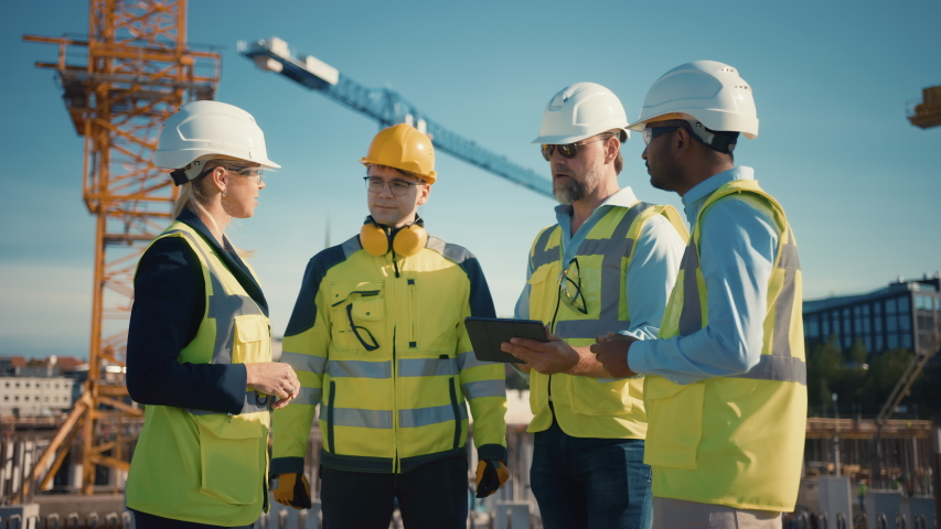 Diverse Team of Specialists Use Tablet Computer on Construction Site. Real Estate Building Project with Civil Engineer, Architect, Business Investor and General Worker Discussing Plan Details. Royalty-Free Stock Footage #1057388131