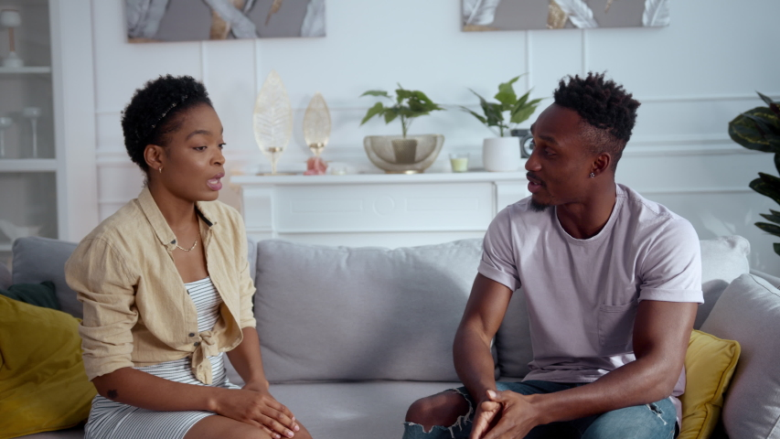 African american young married people experience family crisis having misunderstanding conflict arguing with each other in living room. Home quarrel. Relationships. Royalty-Free Stock Footage #1057389103
