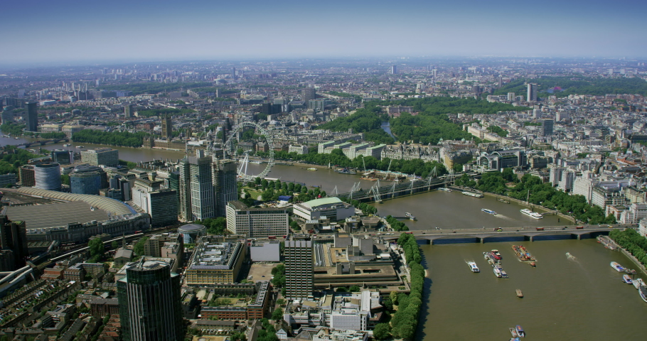 Cloud computing icons with percentages over an aerial view of London. Technology concept, data communication, artificial intelligence, internet of things.  Network connections in a smart city skyline. | Shutterstock HD Video #1057392313