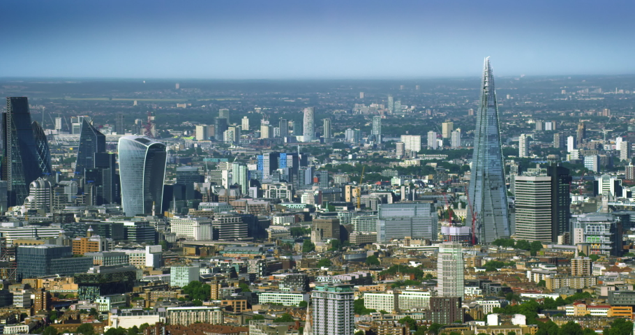 Aerial smart city skyline. Network connections and cloud computing icons with percentages. Technology concept, data communication, artificial intelligence, internet of things. London, England. | Shutterstock HD Video #1057392319