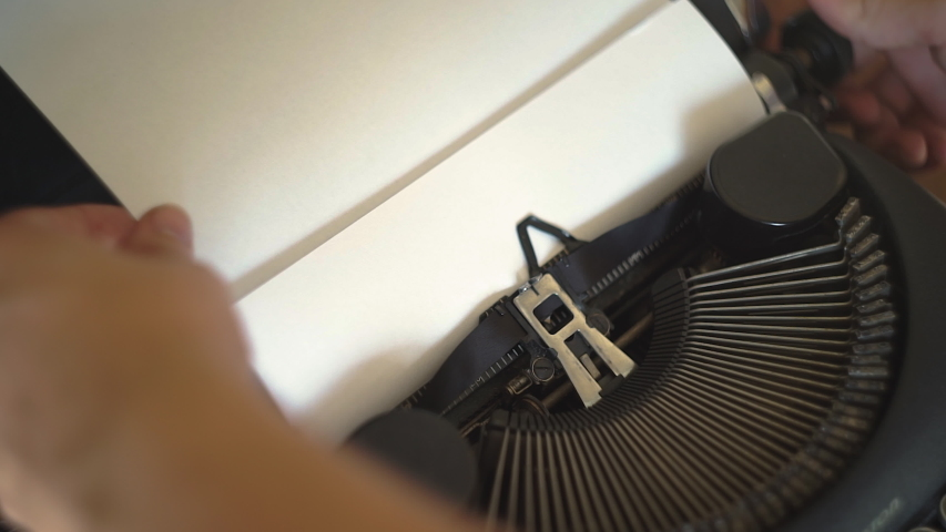 Loading Typewriter with Standard Paper | Shutterstock HD Video #1057395859