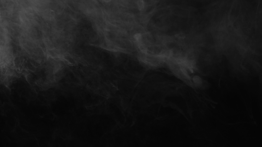 Effect of smoke hovering very slowly on the background from the Vapor collection - Smoke VFX Video Element.   Shutterstock HD Video #1057399357