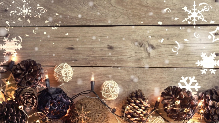 Snowflakes, Flashing lights and pine cone Christmas decoration on wooden table with copy space in vintage style for the celebration on Christmas Day or New Year concept background     Shutterstock HD Video #1057404814