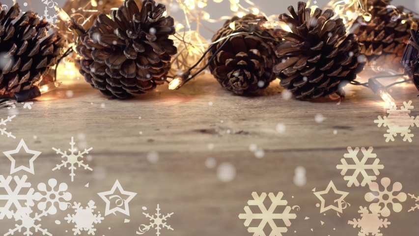 Snowflakes, Flashing lights and pine cone Christmas decoration on wooden table with copy space in vintage style for the celebration on Christmas Day or New Year concept background     Shutterstock HD Video #1057404817