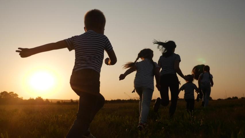 Children happy family kid together run in the park at sunset silhouette. people in the park concept. mom daughter and son joyful run. happy family and little baby child summer kid dream concept fun | Shutterstock HD Video #1057405033