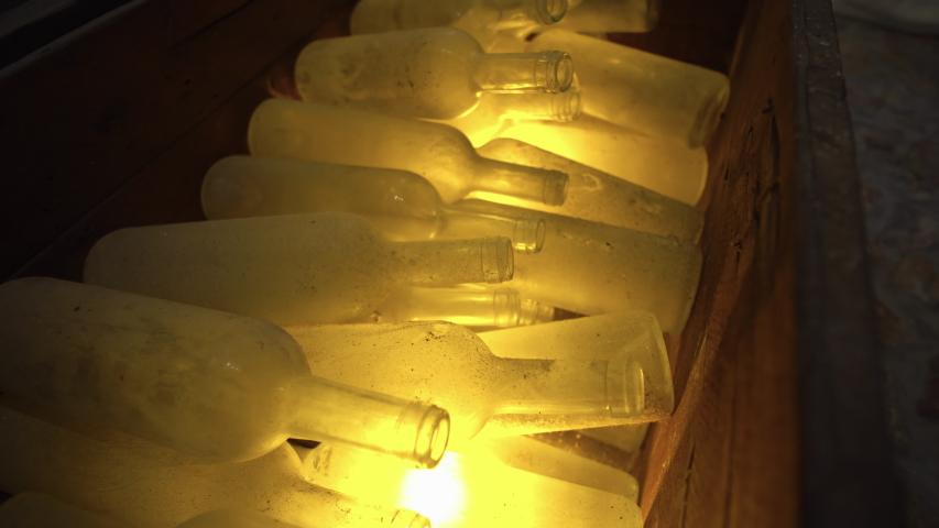 Santorini, Greece. Empty vintage glass bottles    Shutterstock HD Video #1057406128