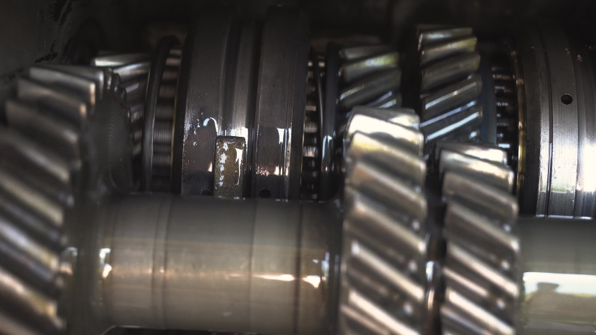 Gears Turning in Machine. Retro gritty Cogs look of american made machinery. Concept piece for thinking with brain   Shutterstock HD Video #1057406326
