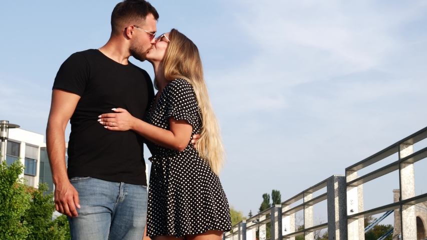 Video of a young couple who romantically kissing on the street  | Shutterstock HD Video #1057406377