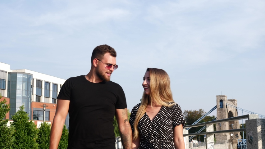 Video of a young couple who romantically walking on the street  | Shutterstock HD Video #1057406473