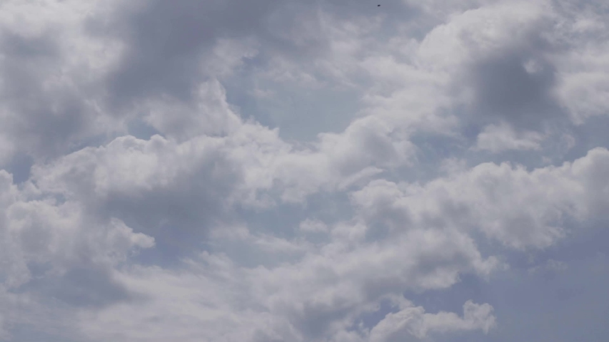 Timelapse with clouds filling the sky. | Shutterstock HD Video #1057407676