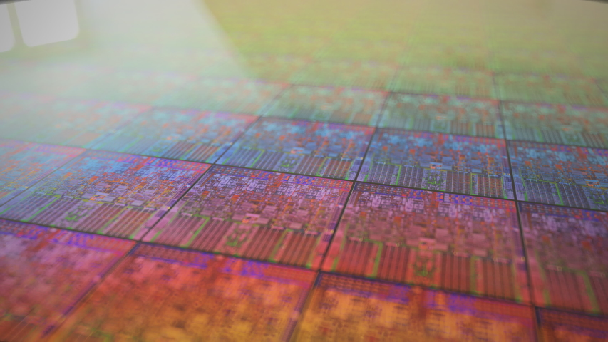 Silicone wafer with iridescent CPU litography. Royalty-Free Stock Footage #1057426510