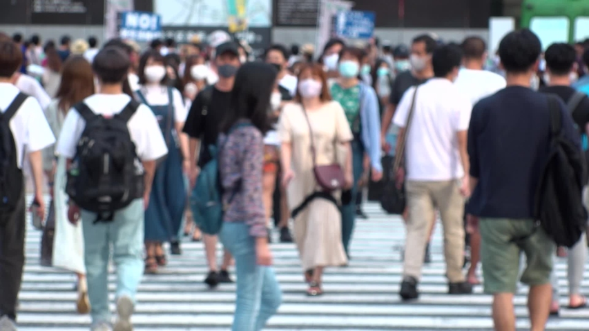 SHIBUYA, TOKYO, JAPAN - AUG 2020 : Back shot and crowd of people wearing surgical mask to protect from Coronavirus (COVID-19) at Shibuya Crossing. Shot in day time, hot summer season. Slow motion. | Shutterstock HD Video #1057427320