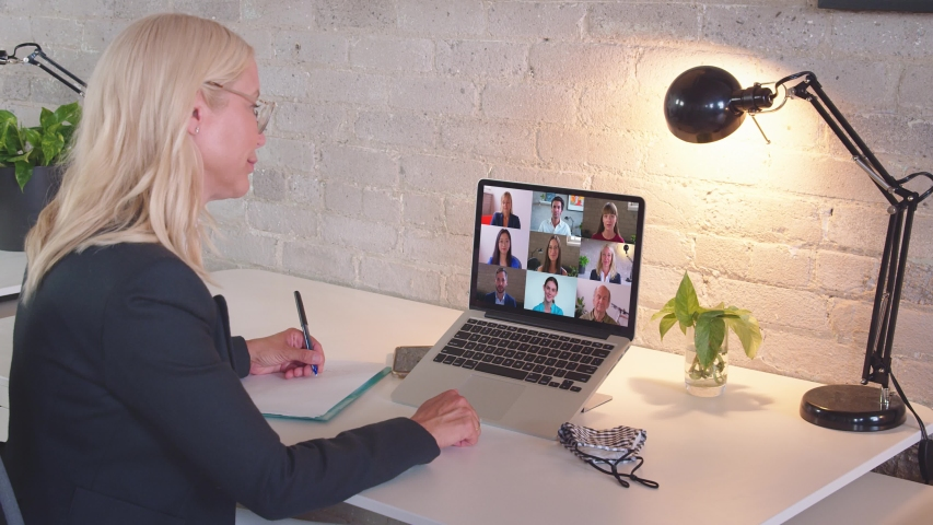 Caucasian business woman remote worker video conferencing boss and colleagues by online call, employees team chat working from home office. Group videocall discussion concept | Shutterstock HD Video #1057443343