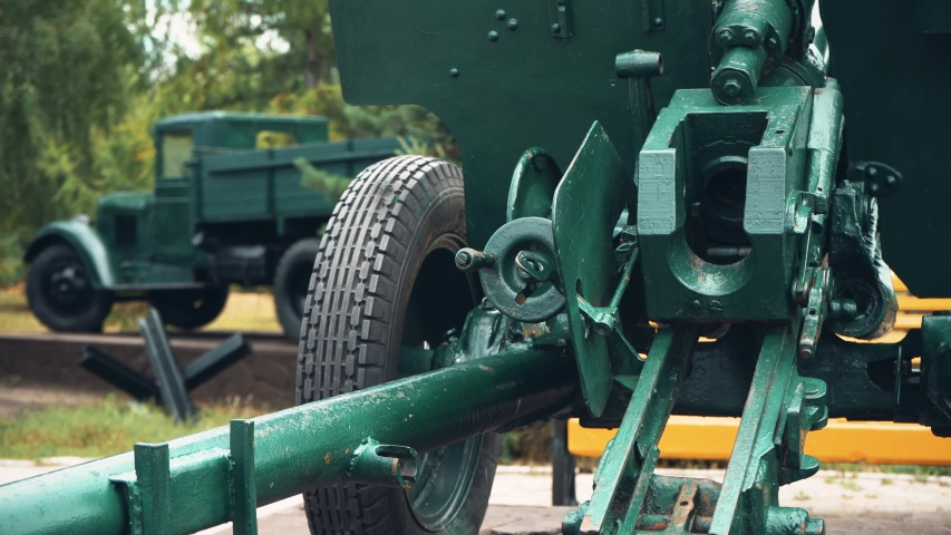 Military howitzer on the background of an army truck