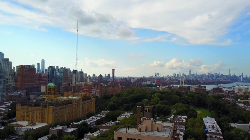 This videos shows aerial views of the Brooklyn and Manhattan skyline.  Brooklyn is a borough of New York City. Manhattan is the most densely populated of New York City's 5 boroughs. | Shutterstock HD Video #1057446979