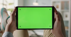 Close up shot of man using a laptop computer, watching a video. Green screen mock up chroma key template 4k footage