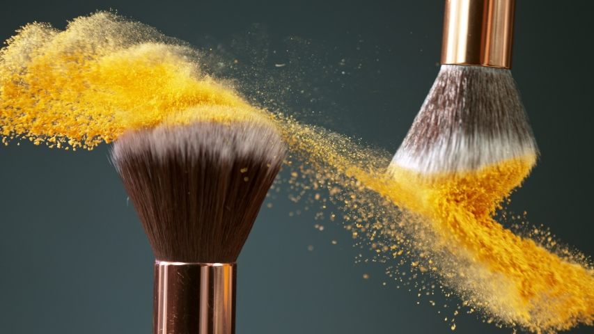 Makeup brushes touch each other on dark background and small particles of cosmetics, super slow motion, 1000 fps. | Shutterstock HD Video #1057466929