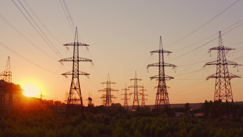 High voltage electric towers at sunset. Transmission power line. Parts of electrical equipment and high voltage power line insulators in the evening. Royalty-Free Stock Footage #1057492258