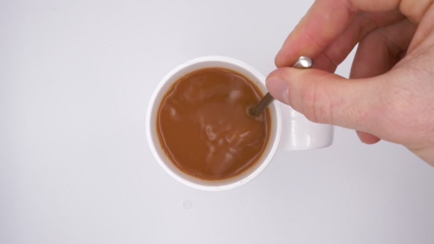 Slow Motion Stirring A Hot Drink in a White Mug   Shutterstock HD Video #1057494349