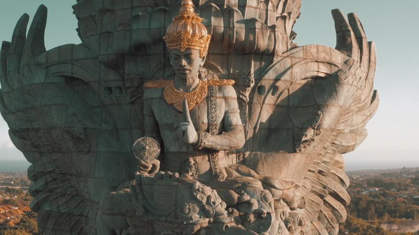 Bali's Most Iconic Landmark Hindu God Garuda Wisnu Kencana statue also GWK statue is a 122-meter tall statue located in Garuda Wisnu Kencana Cultural Park, Bali, Indonesia. Royalty-Free Stock Footage #1057513738
