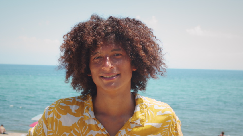 Portrait of a smiling african american young man, happy smiling latin male, Afro curly haircut. Stylish young brazilian student on street, dreadlocks dreads hair. Royalty-Free Stock Footage #1057515406