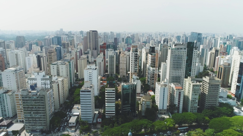 Aerial view tracking above the buildings of Sao Paulo shot in 4K. Sao Paulo. Brazil.