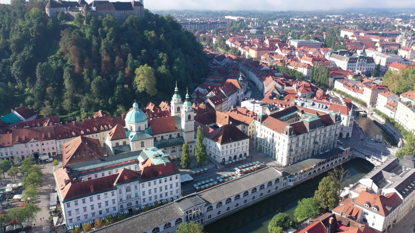 View from drone of residential areas of Slovenian city of Ljubljana in sunny day Royalty-Free Stock Footage #1057546525