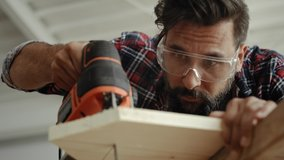 Video of carpenter sawing wood with an electric jigsaw. Shot with RED helium camera in 8K
