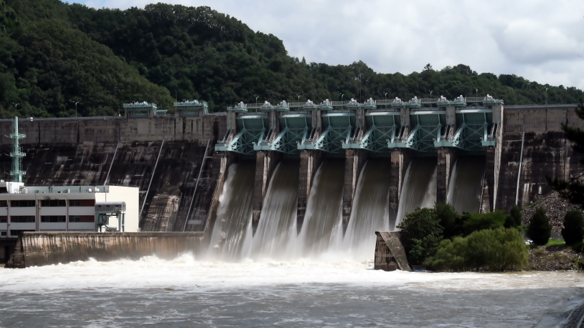 Water surging through flood gates of dam after torrential monsoon rains.