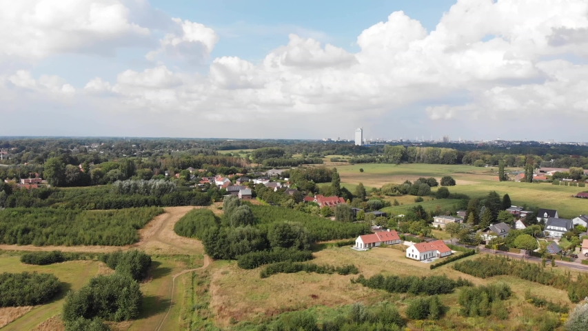 Aerial high angle of De Pinte aerea, agricultural village near Ghent, Belgium. Drone point of view. Royalty-Free Stock Footage #1057560433
